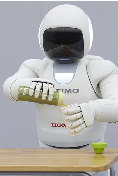 ASIMO pouring tea